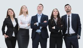 Successful business team looking up. Members of the business team standing close by and looking up Royalty Free Stock Images