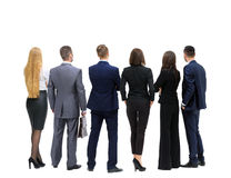 Successful business team looking upwards standing back side Stock Photo