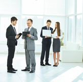 Successful business team before a  meeting in the lobby Royalty Free Stock Images