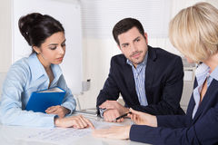 Successful business team in a meeting sitting at desk Stock Photo