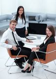 Portrait of successful business team near the desktop Stock Photos