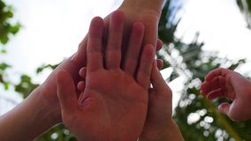 Successful business team of people put hands together in the centre and raise to the sky. Business team of people put hands together in the centre stock footage