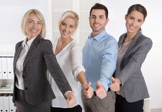 Successful business team in portrait: more woman as men with thu Stock Images