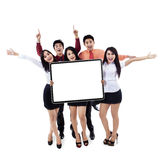 Successful business team showing empty board. On white background royalty free stock photography