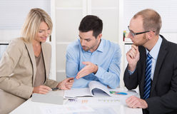 Successful business team sitting around a table in a meeting. Successful business team sitting around a table in a meeting talking about strategy royalty free stock photos