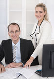 Successful business team: smiling man and woman in portrait in t Stock Photography
