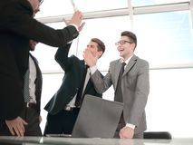 Successful business team standing near the desktop. Concept of success royalty free stock photo