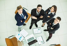 Successful business team standing next to each other near the workplace in the office Royalty Free Stock Photography