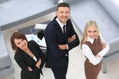 Successful business team standing in office and looking at camera. The view from the top Stock Photo