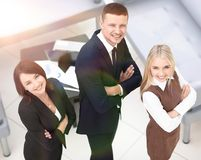 Successful business team standing in office and looking at camera. The view from the top Stock Photos