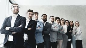 Successful business team standing in row at office stock photo