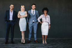 Successful business team standing together and smiling. Full length portrait of successful business team standing together and smiling. Diverse business people stock photos