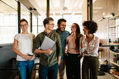 Successful business team standing together and smiling royalty free stock photo