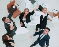Happy business people throw into the air the documents. Successful business team throws into the air the documents Stock Photography