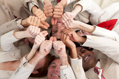 Successful business team with thumbs up Royalty Free Stock Photos