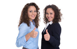 Successful business team: two isolated woman; real twins. Stock Images