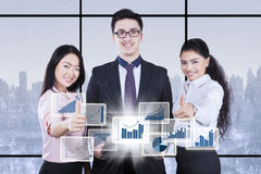 Successful business team with winter background Stock Images