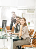 Successful business team at work in the office on a work day. Business team at work in the office on a work day.the photo has a empty space for your text Royalty Free Stock Photo