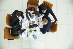 Successful business team working on a financial report on the company`s profits Stock Photos