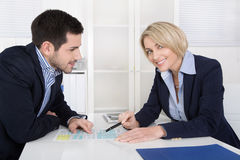Successful business team in the yearly performance review. Successful business team in the yearly performance review talk sitting at desk Stock Photo