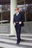 Successful business teen in street setting Stock Images
