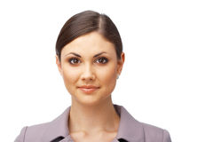 Successful business woman. Pretty young business woman  looking at you on white background Royalty Free Stock Image