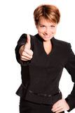 Successful business woman. Close-up of a young woman showing thumbs up Royalty Free Stock Photos