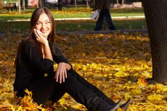The successful business woman. The girl in park speaks by phone Royalty Free Stock Photography