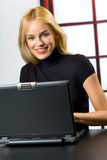 Successful business woman. Young happy smiling successful business woman or student on laptop, working, chatting, playing, searching in internet royalty free stock images