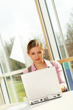Successful business woman. A successful business woman is working on a table with a laptop Royalty Free Stock Image