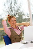 Successful business woman. A successful business woman is working on a table with a laptop Royalty Free Stock Images