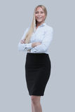 Successful business woman with arms crossed - isolated over whit. Bright picture of friendly young smiling businesswoman Stock Images