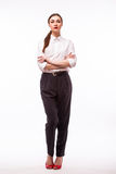 Successful business woman with arms crossed. Over white Stock Photos