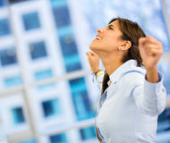 Successful business woman with arms up Stock Photos