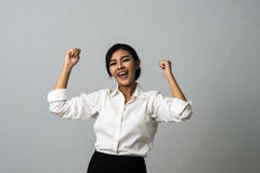 Successful business woman with arms up celebrating Royalty Free Stock Images