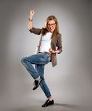 Successful business woman with arms up - isolated over a gray Stock Photos