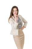 Successful business woman asks silence. Pressed a finger to her lips Stock Image
