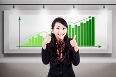 Successful business woman with bar chart Stock Image
