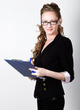 Successful business woman in a business suit and glasses holding folder Stock Images