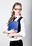 Successful business woman in a business suit and glasses holding folder Stock Image