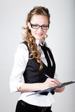 Successful business woman in a business suit and glasses holding folder Royalty Free Stock Image