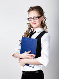 Successful business woman in a business suit and glasses holding folder Royalty Free Stock Photography