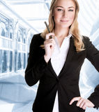 Successful business woman. Successful businesswoman talking on the phone, waiting for a business partner, serious people, success and career concept Stock Images