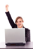 Successful business woman celebrating victory while sitting at o Royalty Free Stock Photography