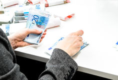 Successful business woman is counting money bills ona a desk Royalty Free Stock Photos