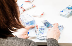 Successful business woman is counting money bills ona a desk Stock Images