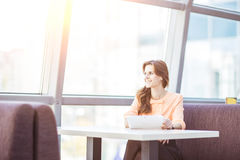 Successful business woman with digital tablet sitting at Desk in the spacious office Royalty Free Stock Photography
