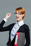 Successful business woman gesturing and holding folder Royalty Free Stock Image