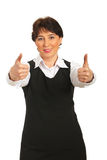 Successful business woman giving thumbs Stock Images