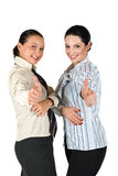 Successful business woman giving thumbs up. Two beautiful business woman giving thumbs up concept of successful partnership,isolated on white background,check Royalty Free Stock Image